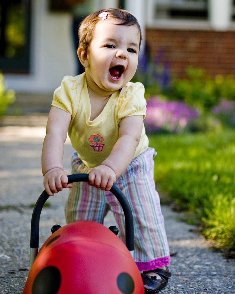 baby with push toy