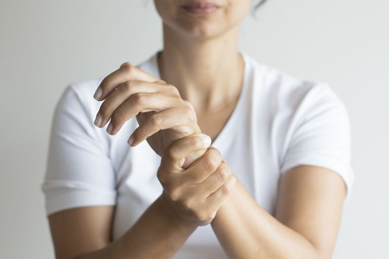 woman holding painful wrist