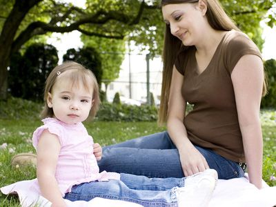 'Adorable Caucasian Baby Girl with Mother at Park, Copy Space'
