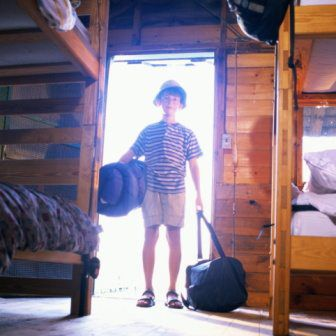 A picture of a boy arriving at a summer camp