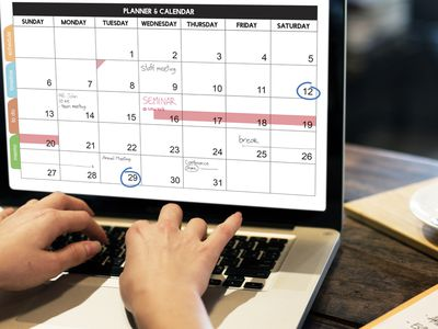 Woman looking at calendar on computer