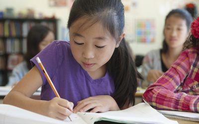 girl working in elementary school class
