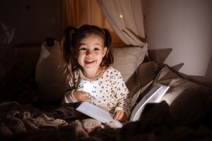 Smiling girl with bedtime story