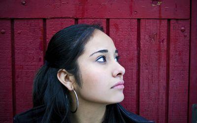 upset teen girl looking away