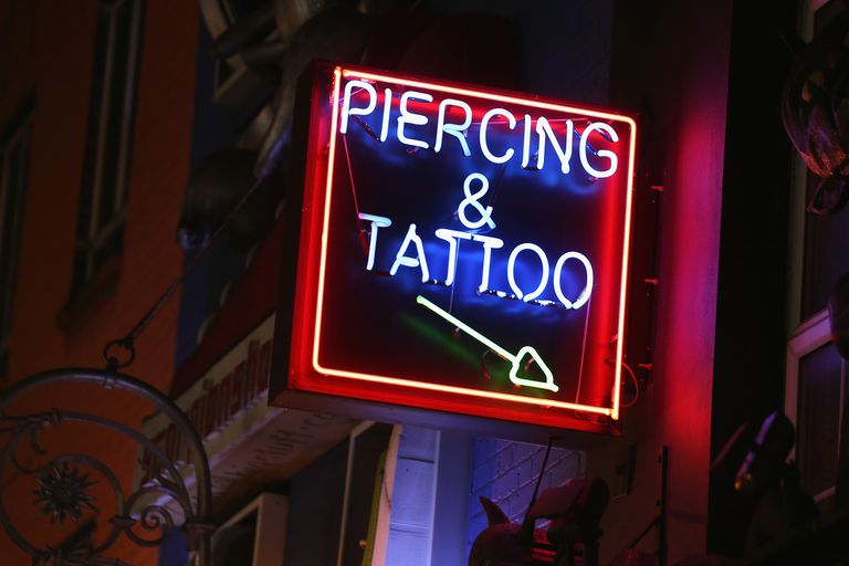 Can teenagers get a tattoo or a piercing without a parent's permission?