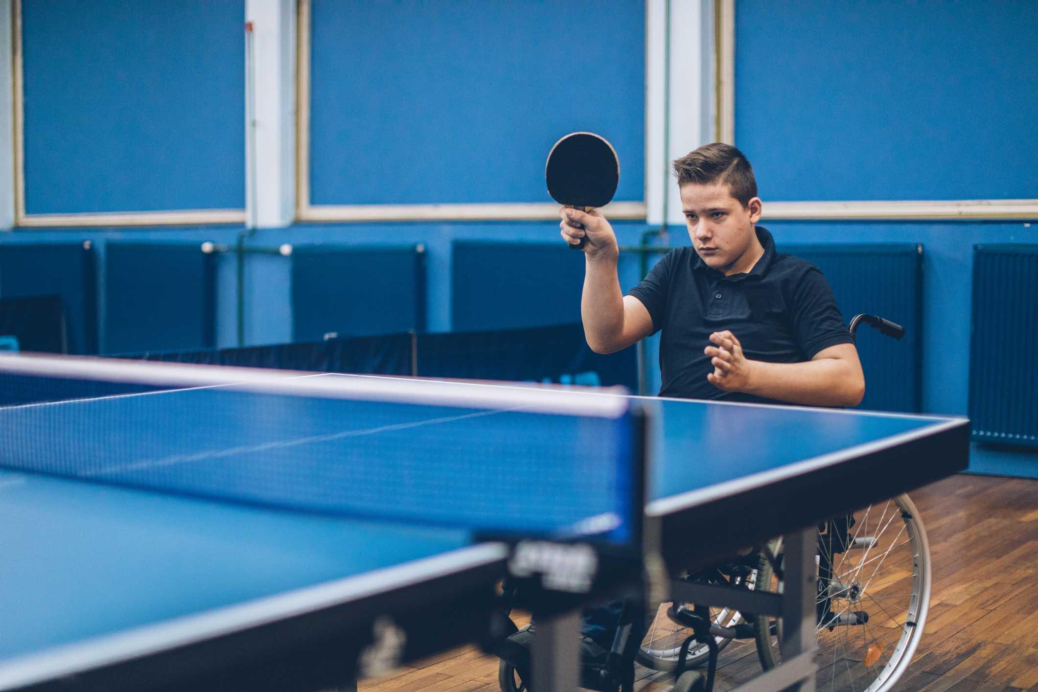 Boy having fun playing table tennis