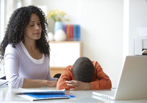 Black mother comforting sad son