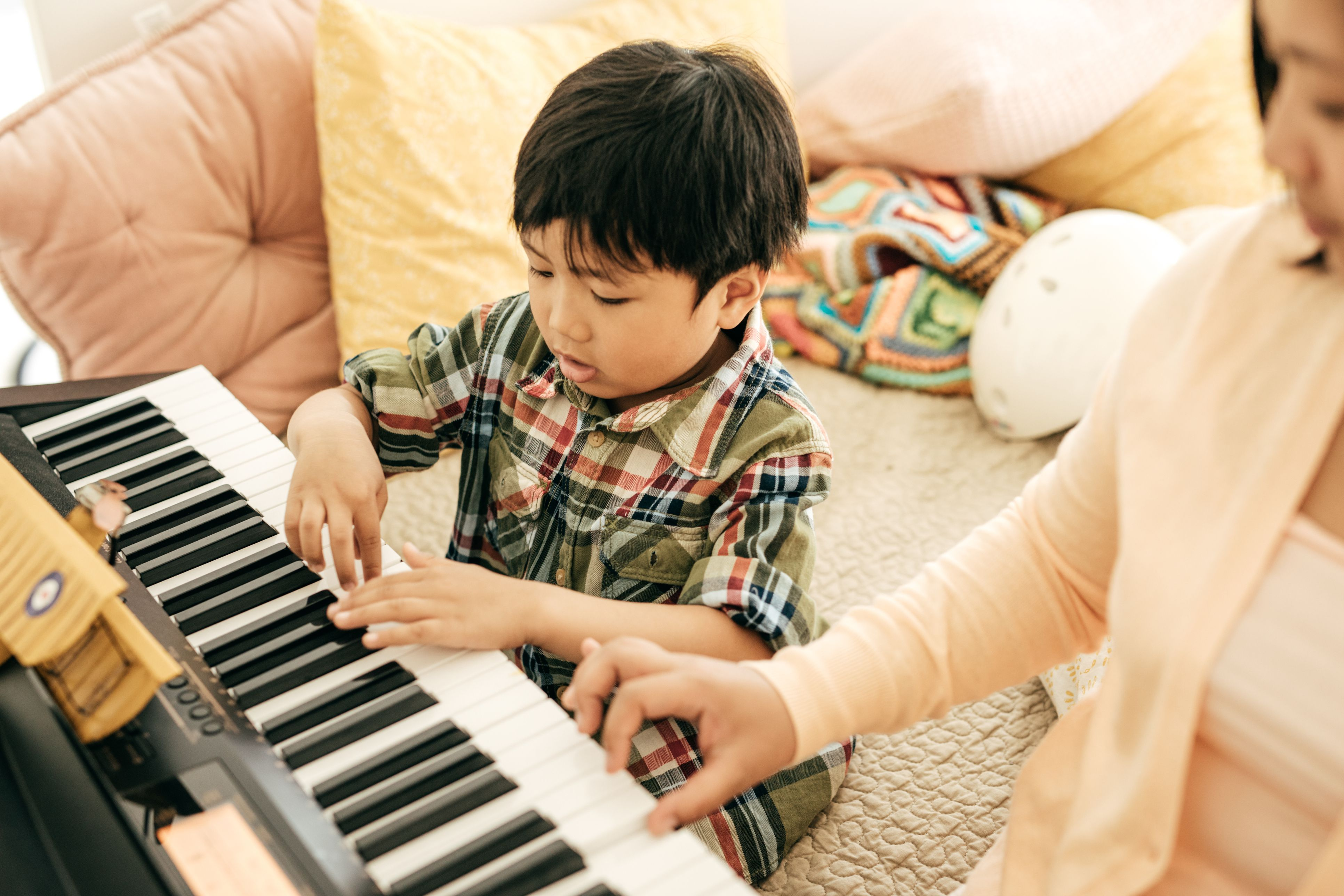Mother and Child playing on keyboard