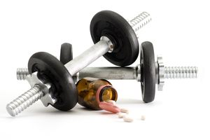 Dumbbells with bottle of Clomid used for doping