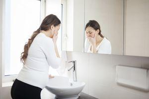 woman in first trimester feeling sick