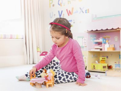 A girl playing dolls