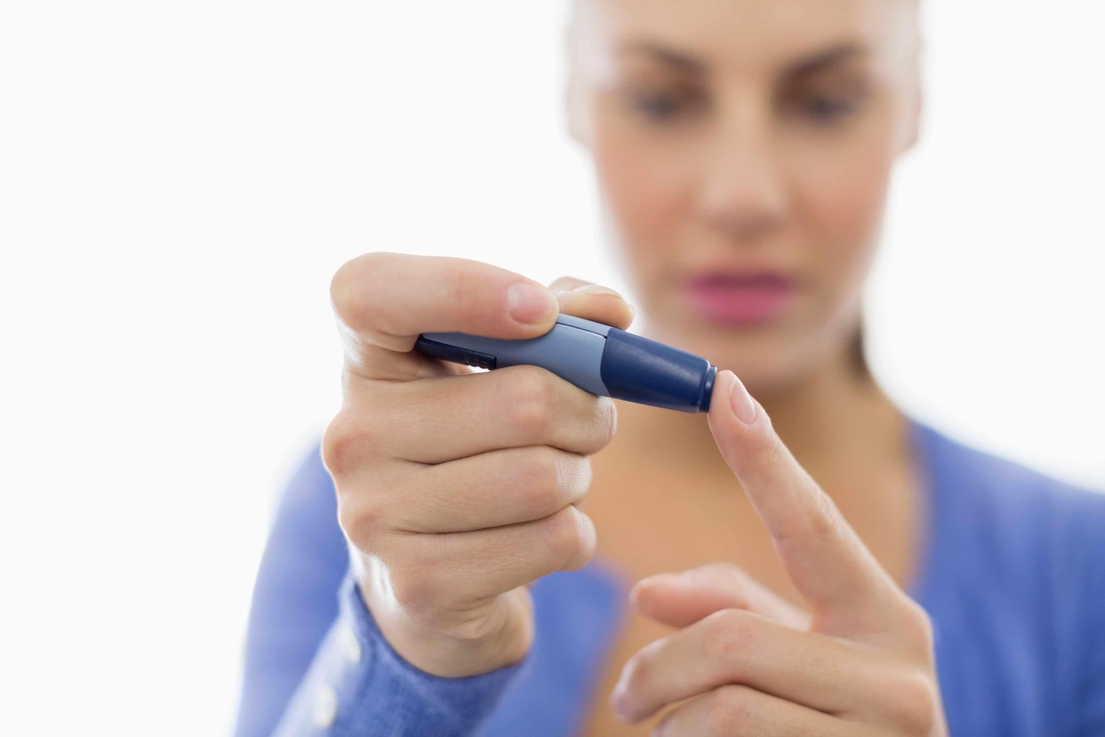 Woman testing her blood sugar