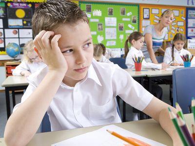 A sad child at school