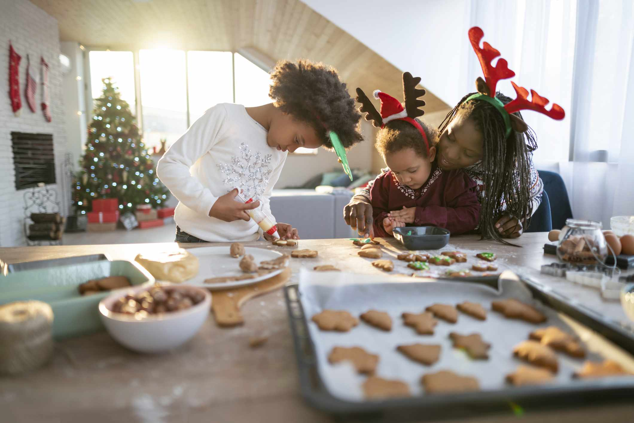 Mother baking Christmas cookies with her young children