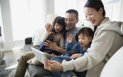 Family waving at iPad