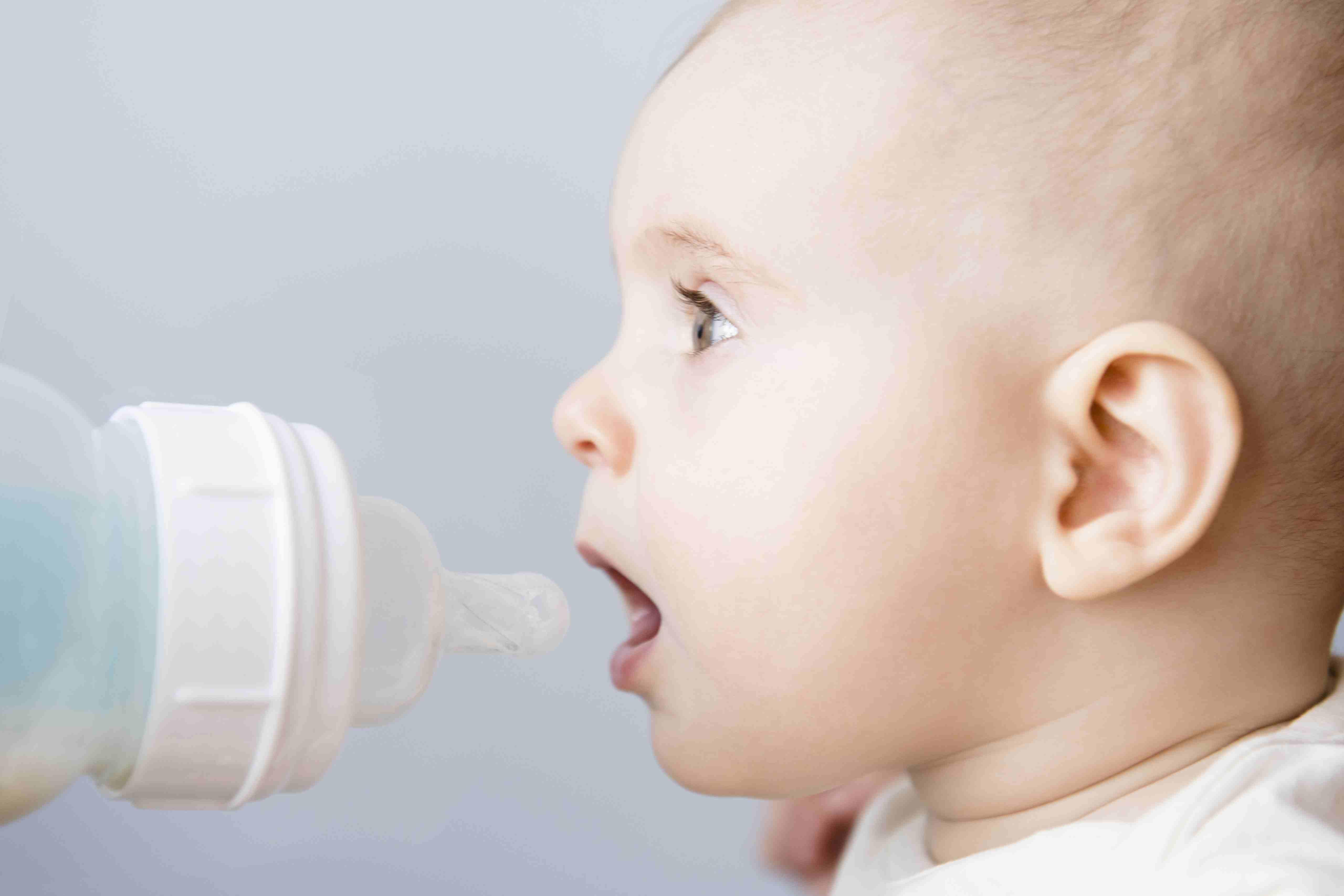 Baby girl drinking bottle