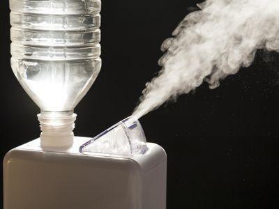 Compact home humidifier creates vapor.