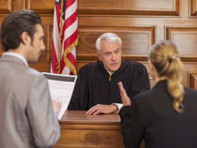 Lawyers pleading case to judge in court
