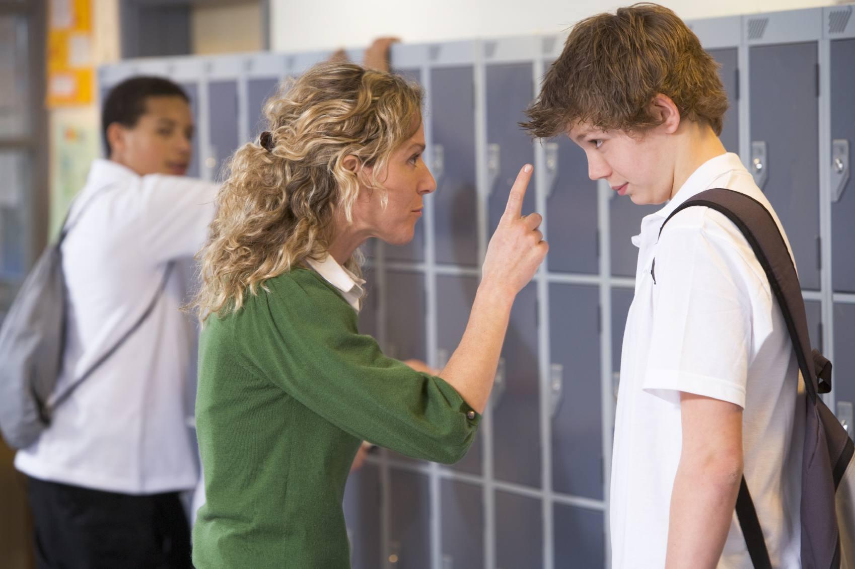 teacher correcting a student