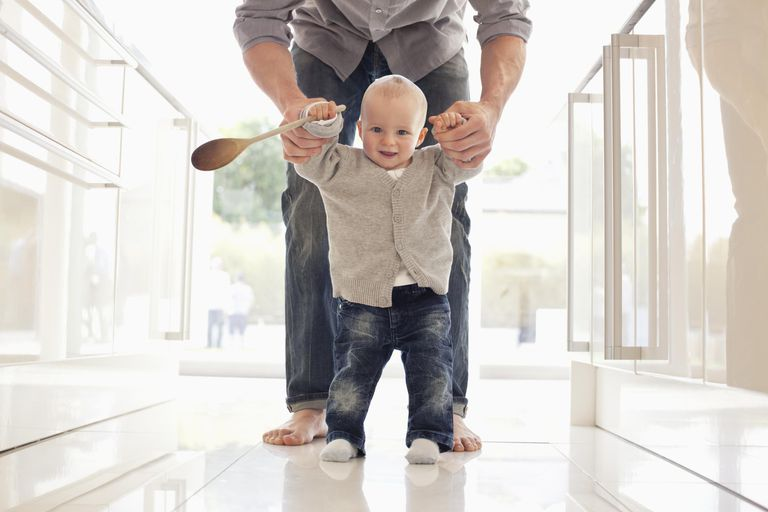 Father helping son learn to walk