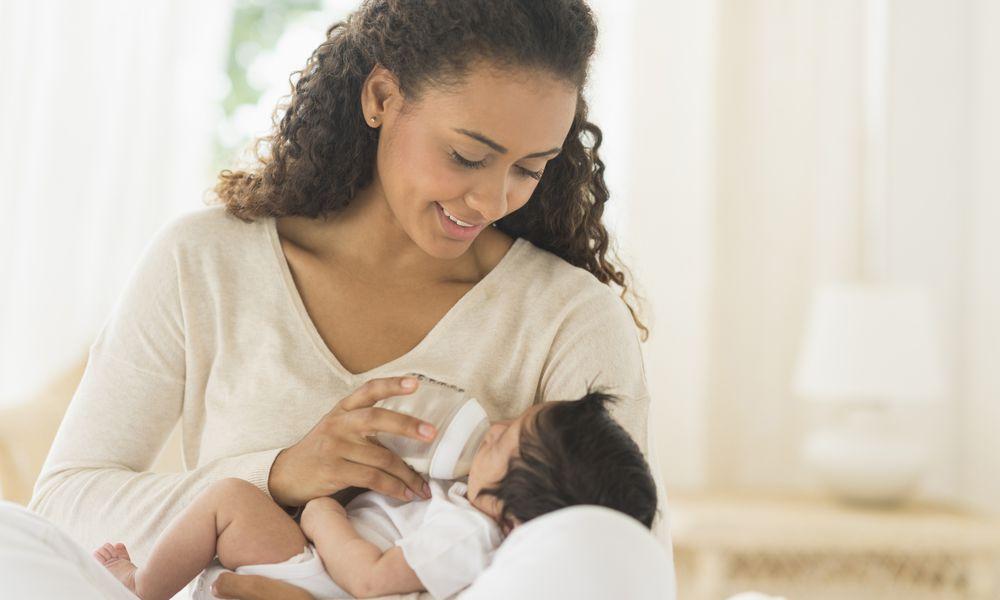 Mother feeding newborn baby
