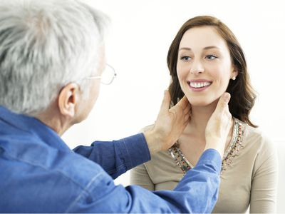 Doctor checking a patient's glands