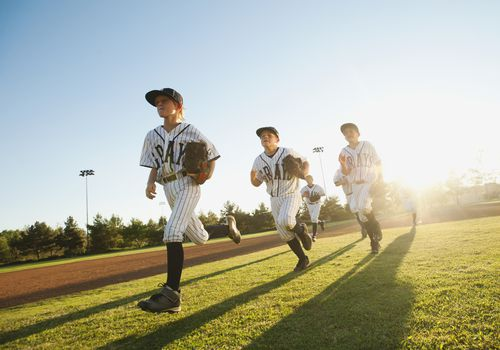 Baseball players running on diamond