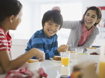 Family fitness lifestyle - siblings having breakfast together