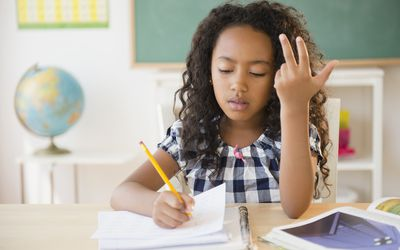 Young girl working on math problems