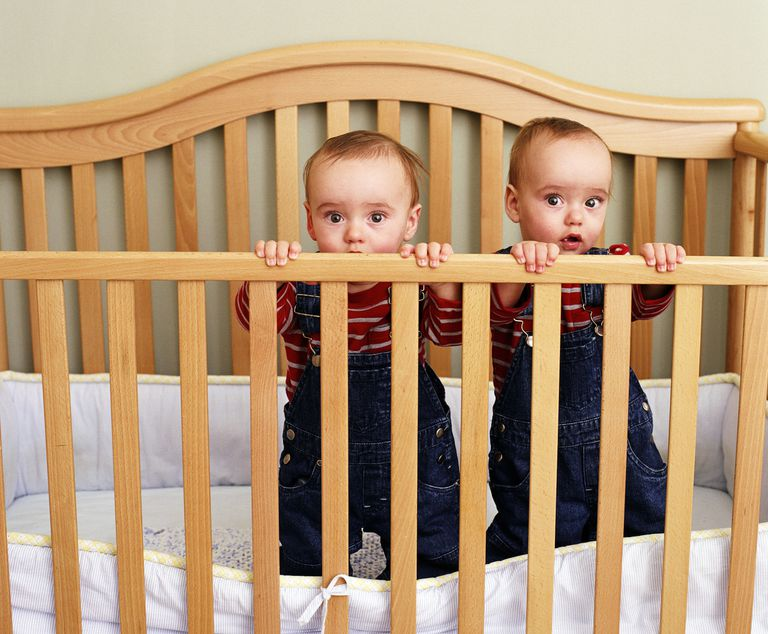 twins together in crib