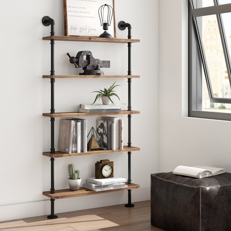 A set of wood and metal pipe shelves, currently for sale at Wayfair