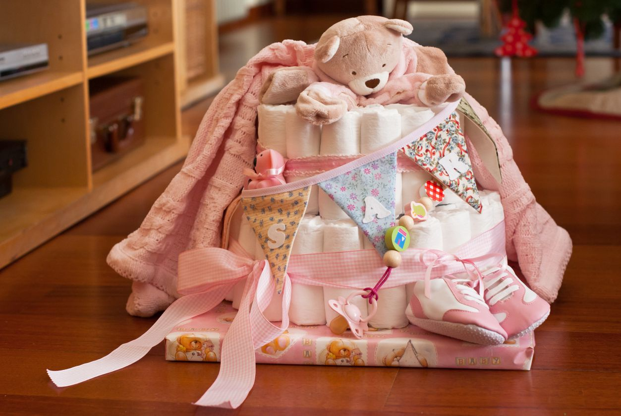 Pink and white diaper cake