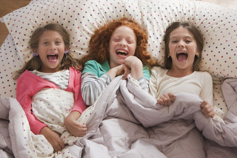 Laughing granddaughters having a sleepover