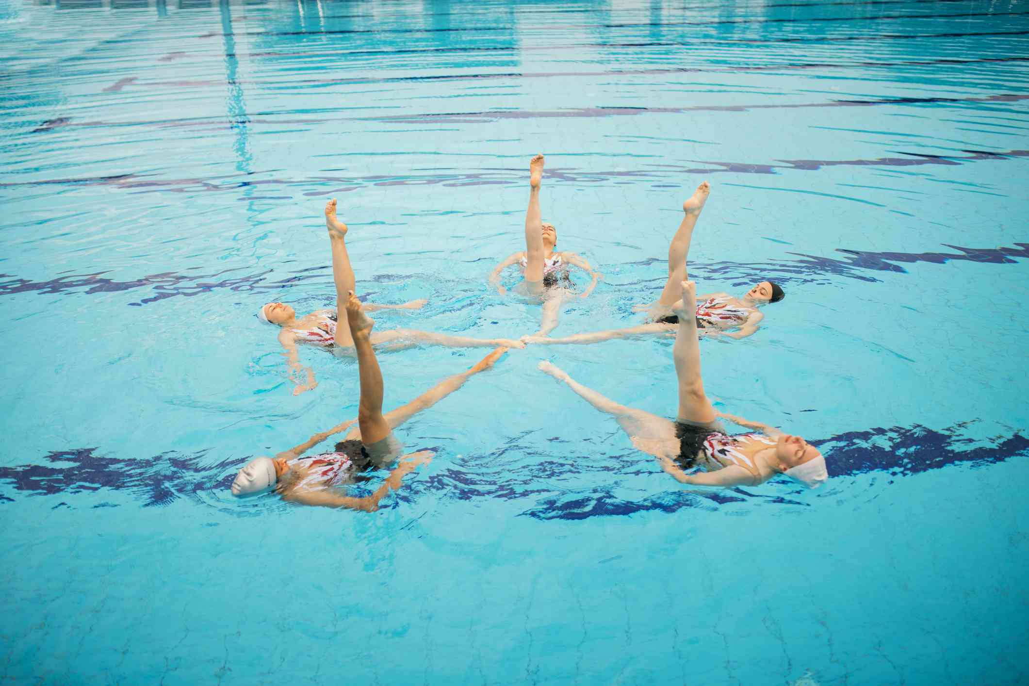 Girls practicing a synchronized swimming routine