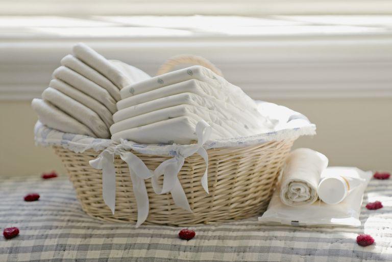 Nappies in wicker basket in front of window sill