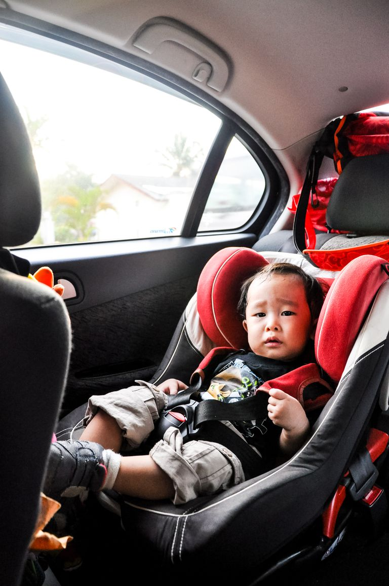 Portrait Of Toddler Sitting In Back Seat Car