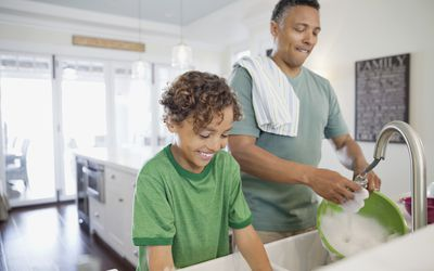 father and son doing dishes