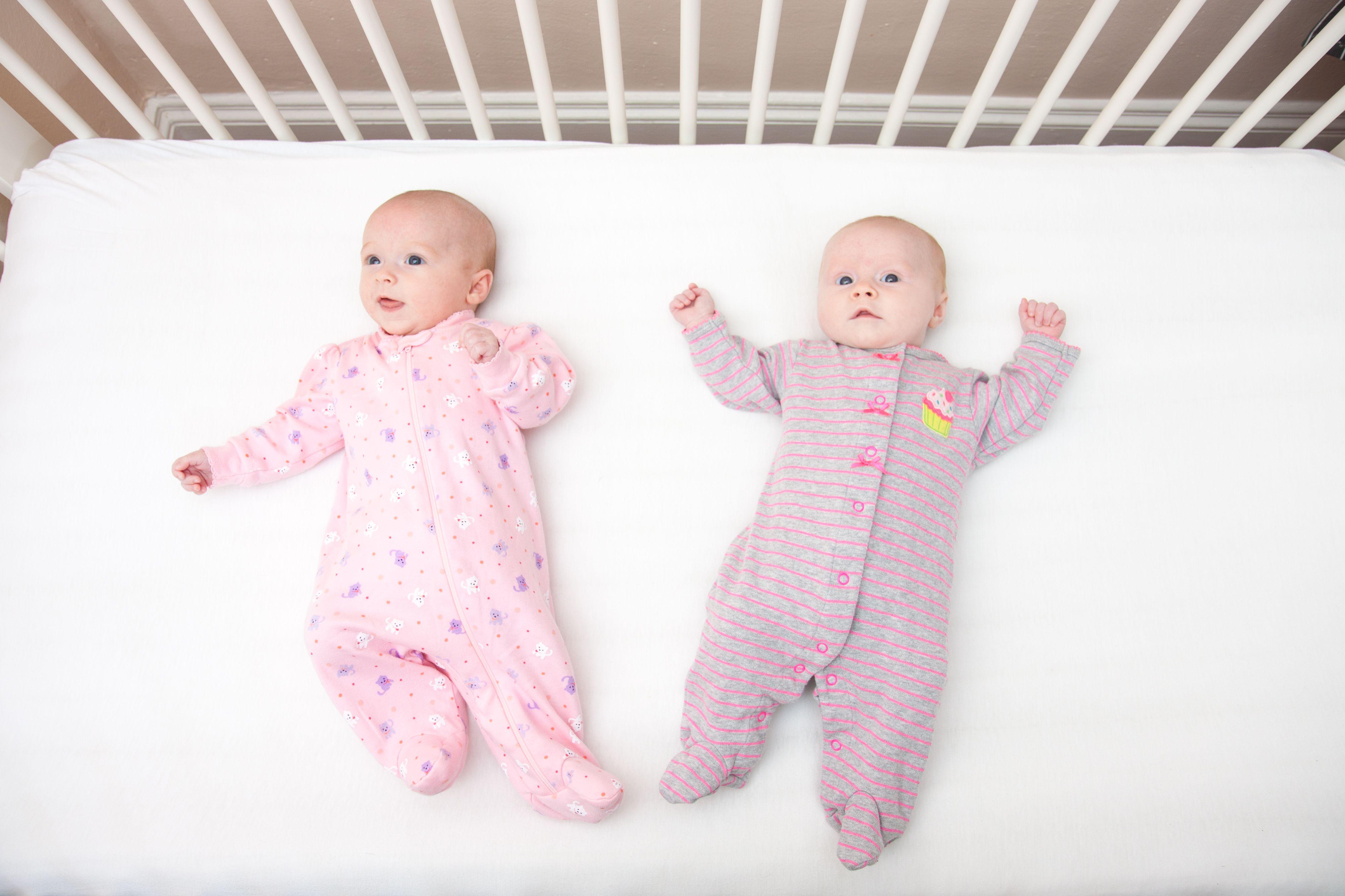 Twins enjoying their crib