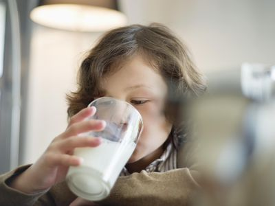 Close-up of a boy drinking a glass of milk
