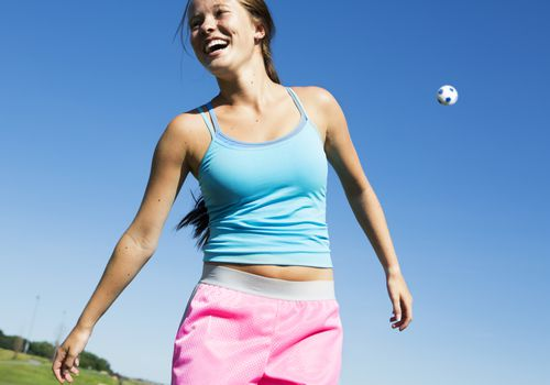 teenage girl playing soccer