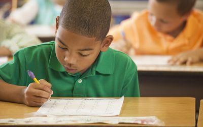 young boy taking test in school