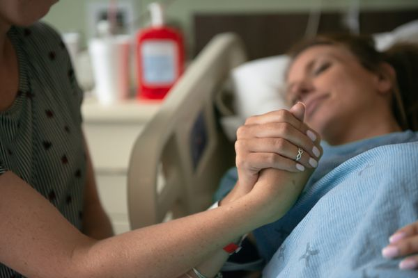 Woman in labor in hospital bed.