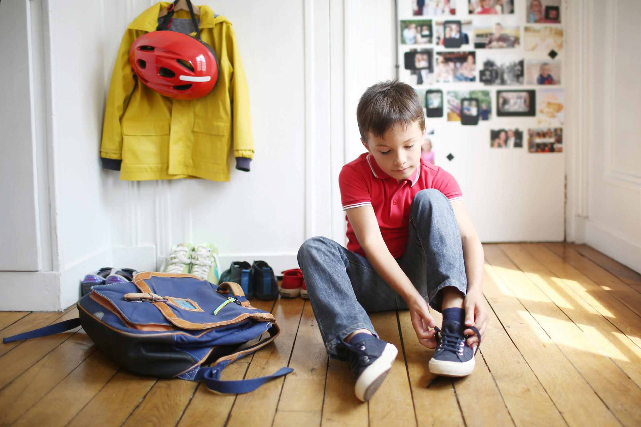 young boy getting ready for school