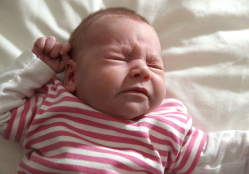 newborn baby girl sneezing