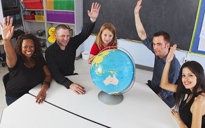 Parents and child at a table in a classroom