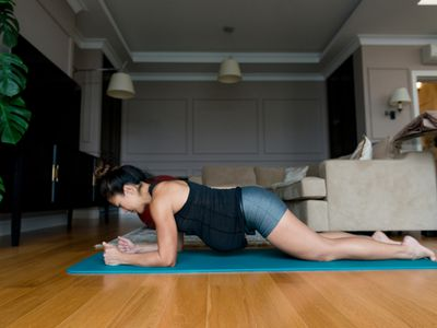 pregnant woman doing plank exercise