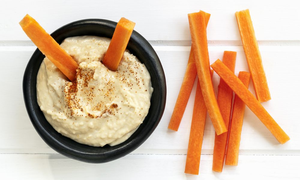 Hummus withcarrot sticks top view