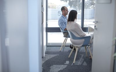 Couple sitting in consulting room at the doctor