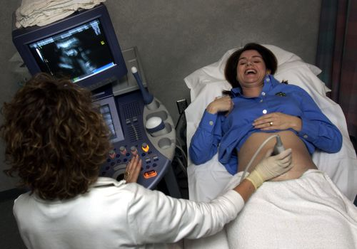 Woman Having Pregnancy Ultrasound