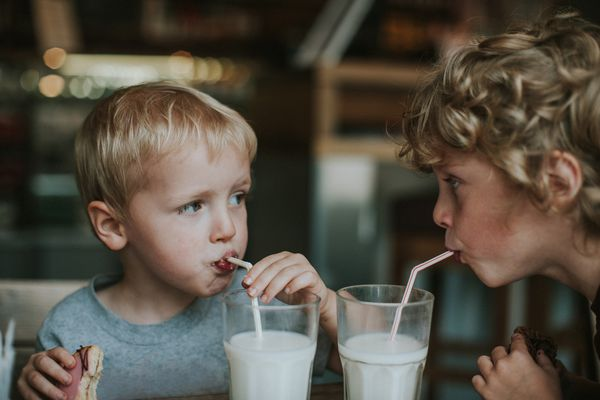 little boys drinking milk out of straws